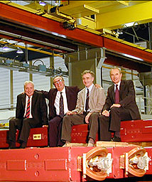 Lyn Evans, Luciano Maiani (CERN's Director General), Alexander Skrinsky, Kurt Hubner, on the last of 360 dipole magnets and 180 quadrupoles from Novosibirsk in Russia